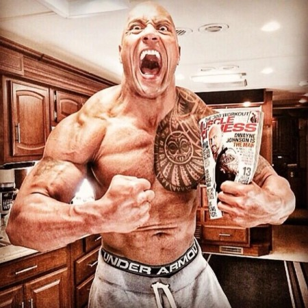 The-Rock-Holding-Muscle-and-Fitness-Mag